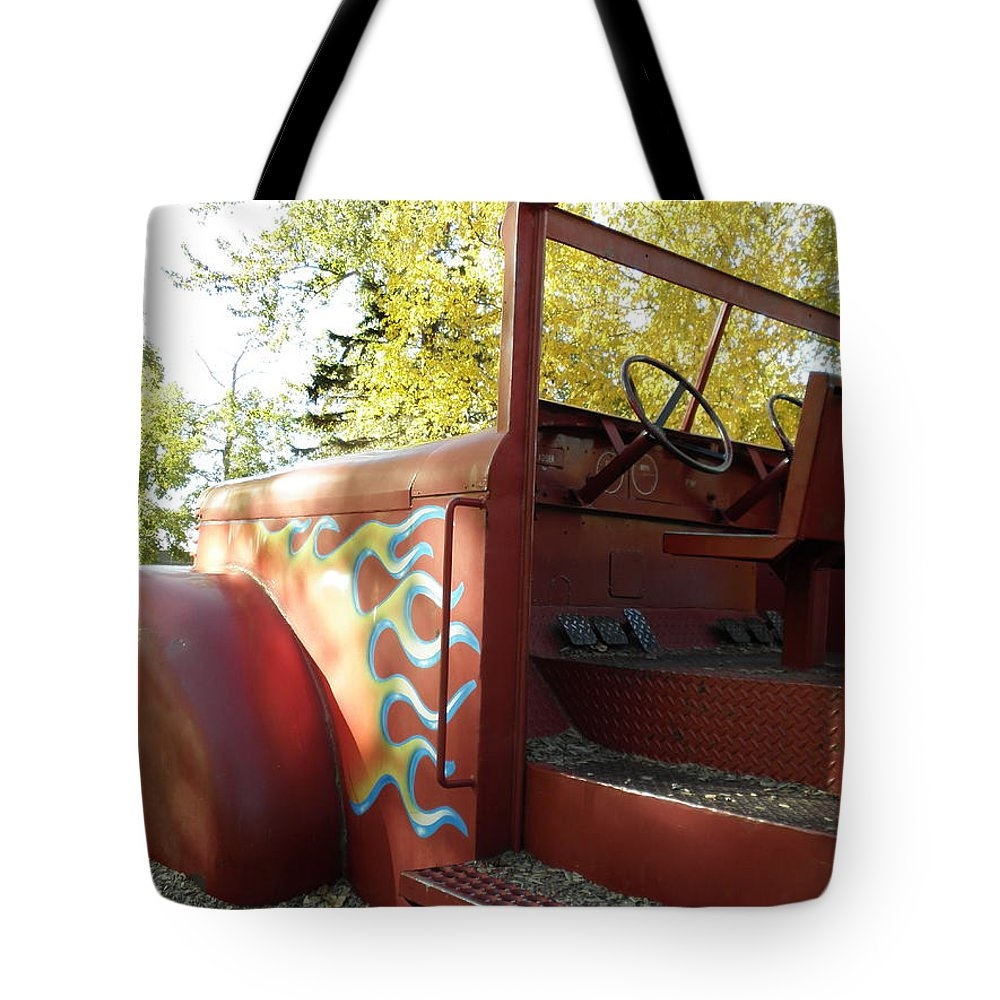Red Tote Bag featuring the photograph Blazing Red Fire Truck by Vivian Martin