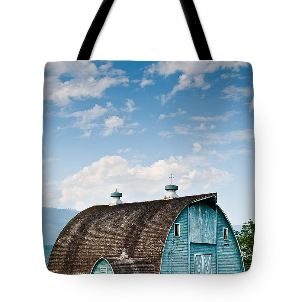Agricultural Activity Tote Bag featuring the photograph Blue Barn In The Stillaguamish Valley by Jeff Goulden