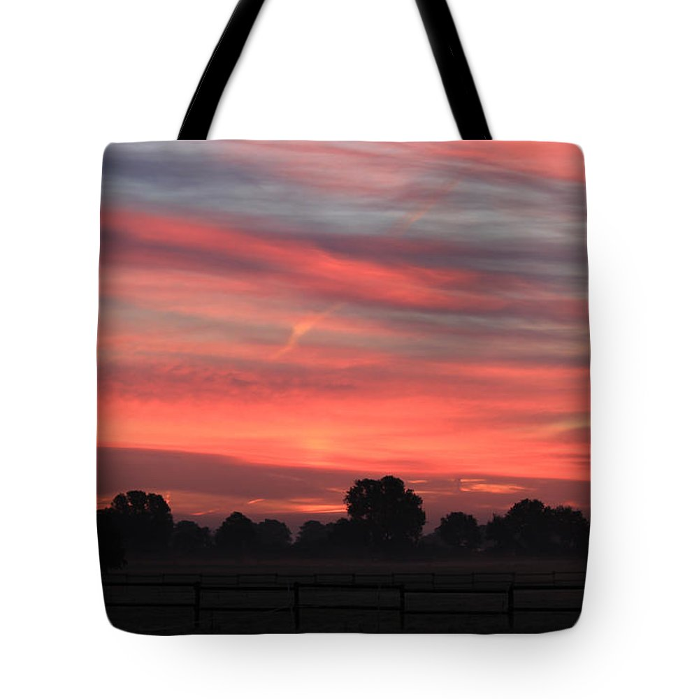 Sunrise Tote Bag featuring the photograph Blue Red Sky by Four Hands Art