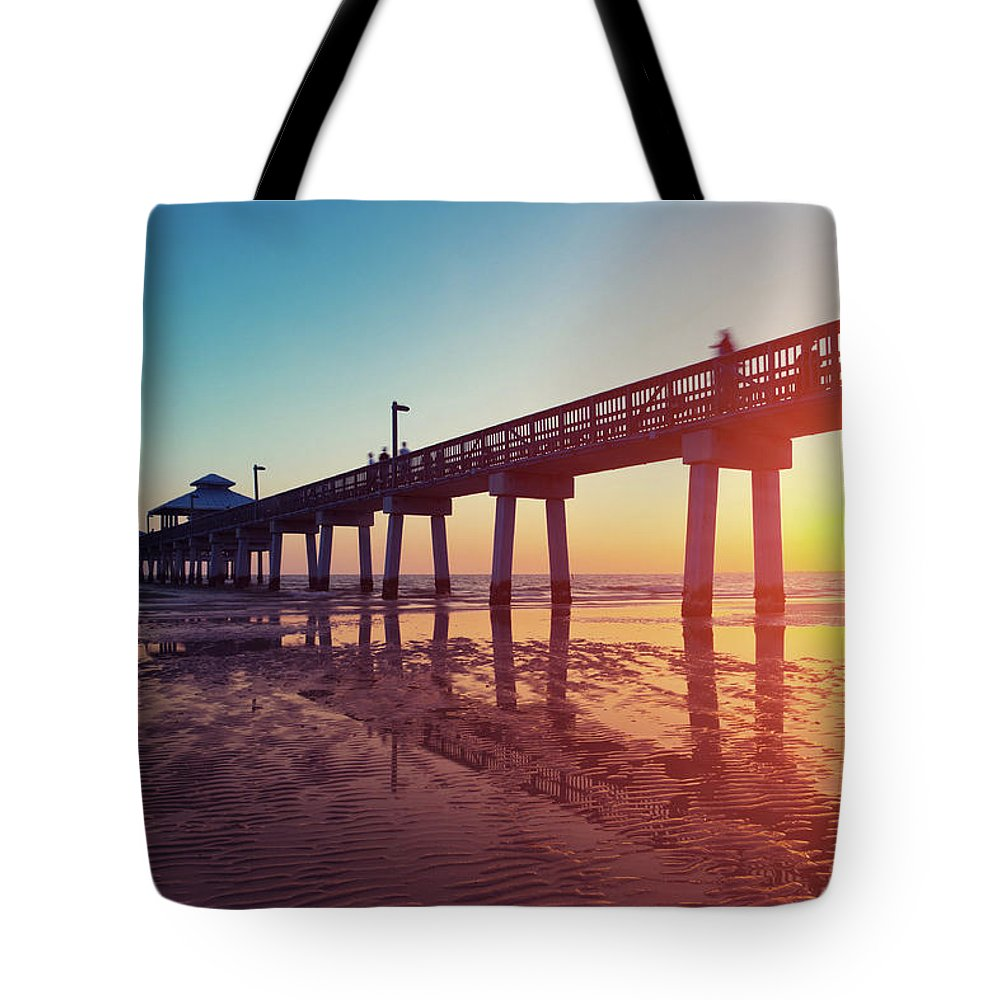 Water's Edge Tote Bag featuring the photograph Boardwalk At Sunset While The Sun by Moreiso