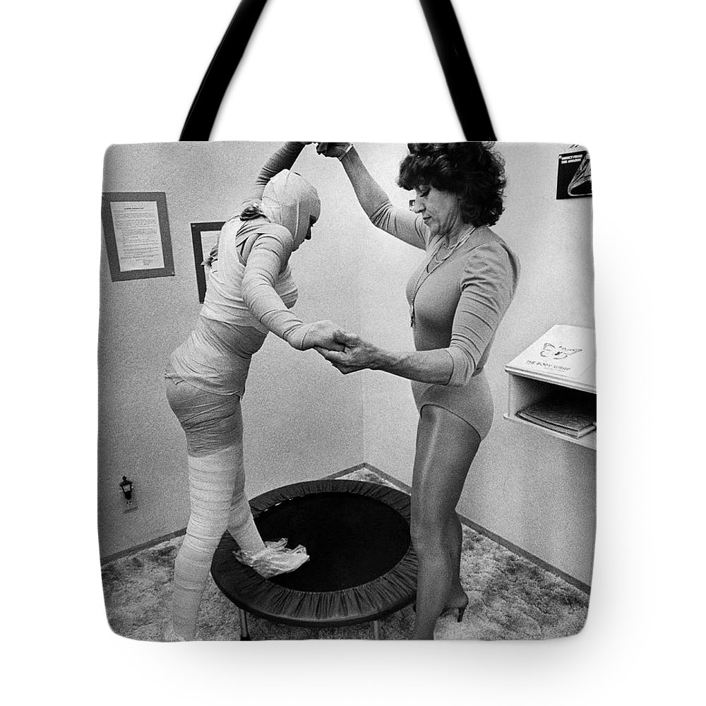 1960s Tote Bag featuring the photograph Body Wrap Exercise by Underwood Archives