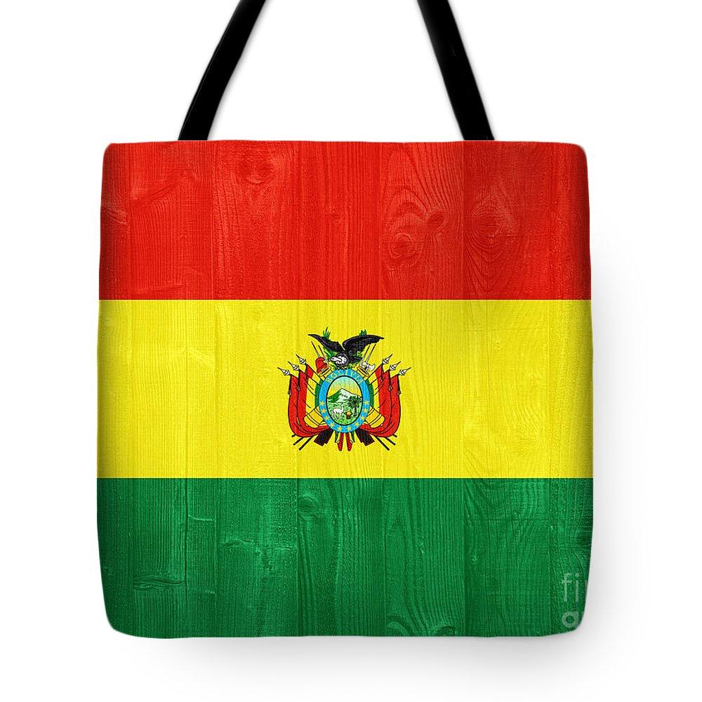 Bolivia Tote Bag featuring the photograph Bolivia Flag by Luis Alvarenga