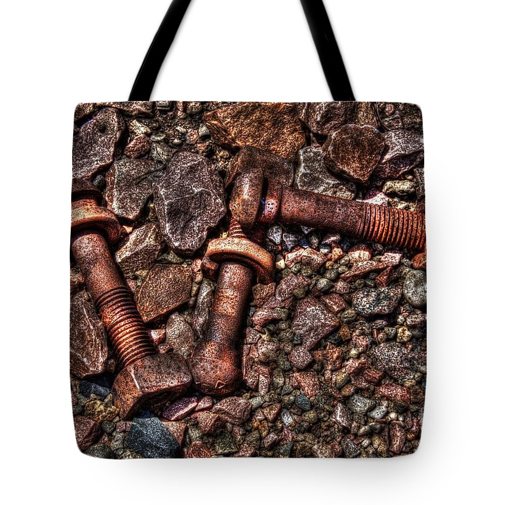 Gravel Tote Bag featuring the photograph Bolts In Gravel by M Dale