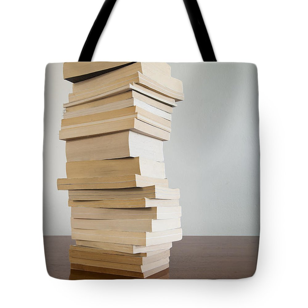 Book Tote Bag featuring the photograph Book Stack On Table by Tim Hester