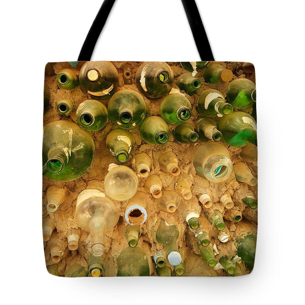 Bottles Tote Bag featuring the photograph Bottles In The Wall by Jeff Swan