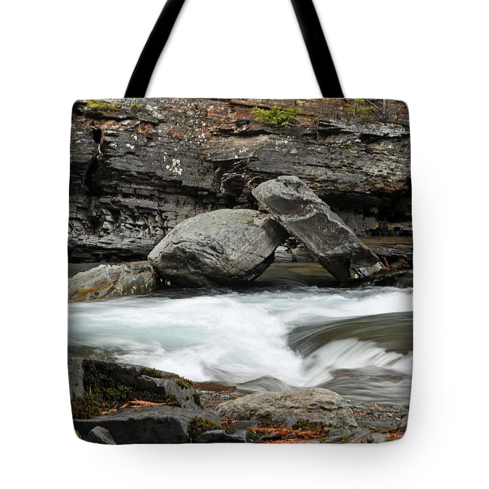Lake Mcdonald Tote Bag featuring the photograph Boulders In Mcdonald Creek by Bruce Gourley