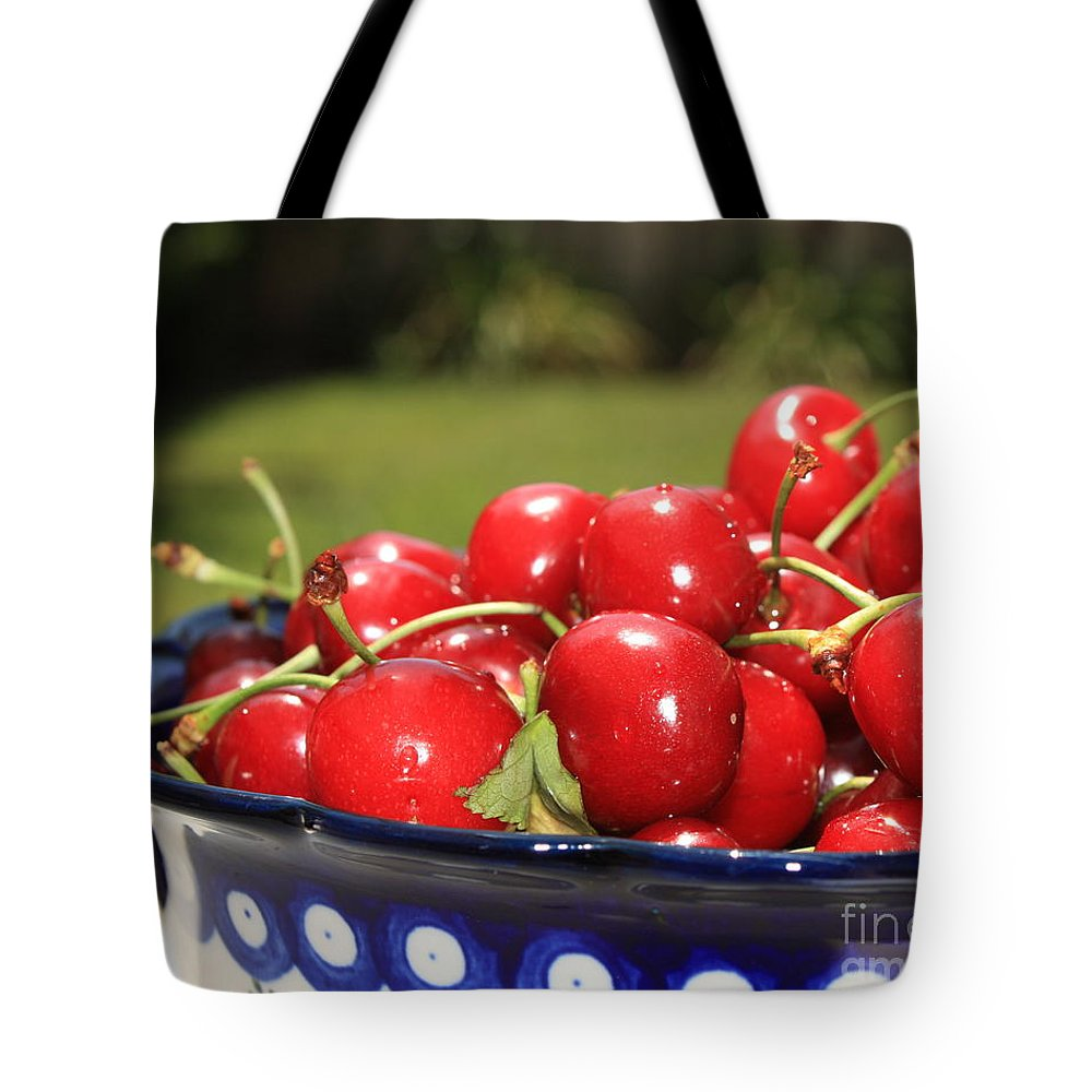 Cherries Tote Bag featuring the photograph Bowl Of Cherries In The Garden by Carol Groenen