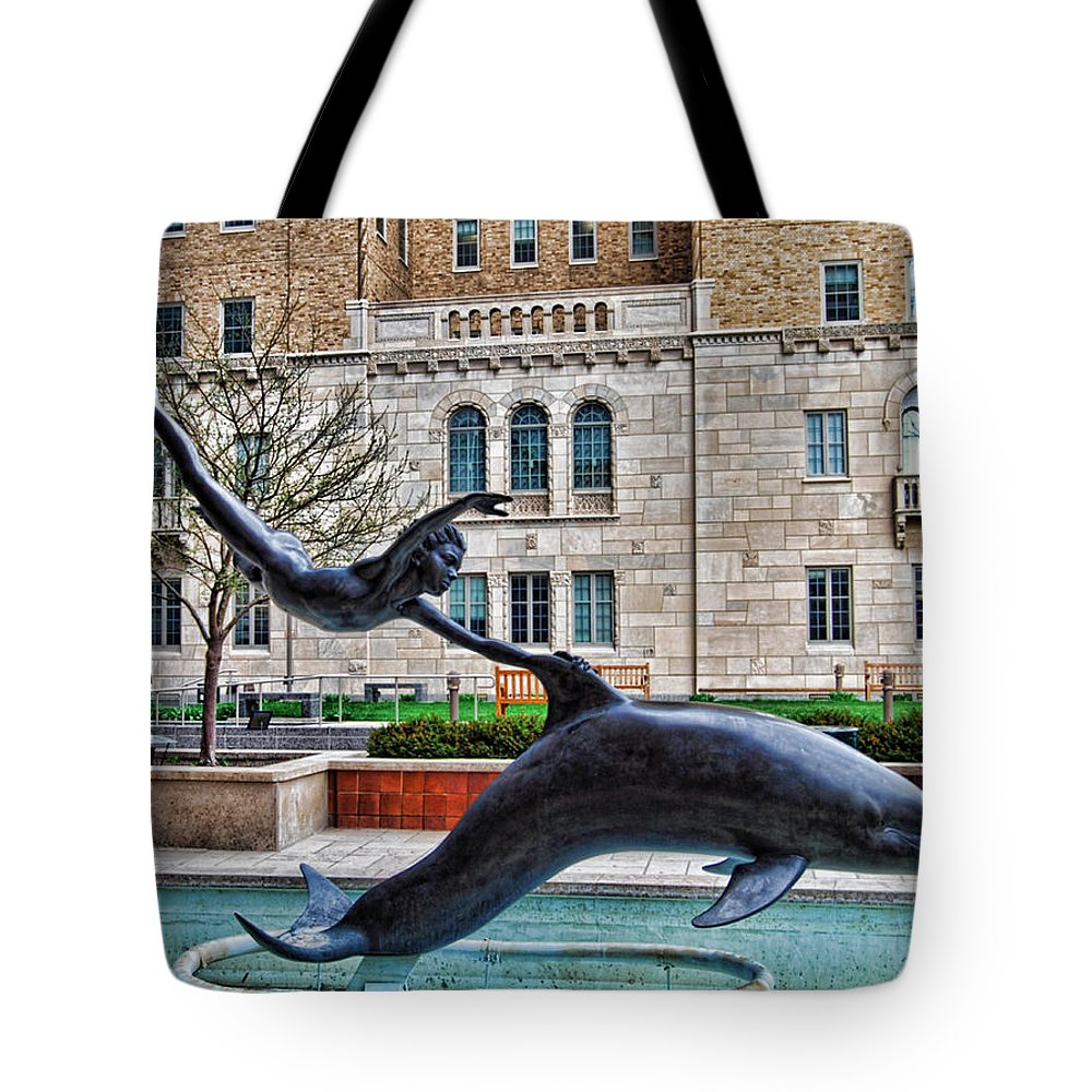 Boy Tote Bag featuring the photograph Boy With A Dolphin by Mark Orr