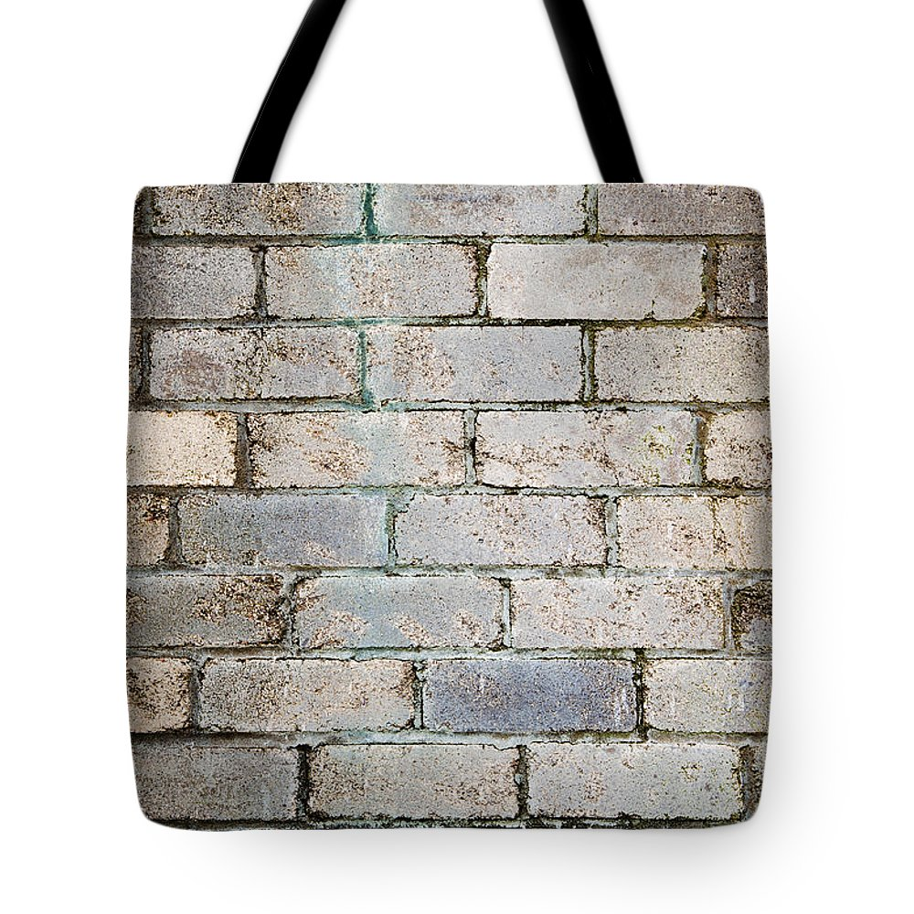 Aged Tote Bag featuring the photograph Brick Wall by Tim Hester