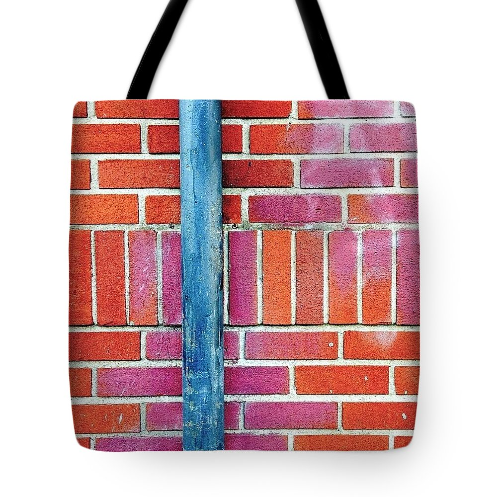 Putridpipes Tote Bag featuring the photograph Brick And Pipe by Julie Gebhardt