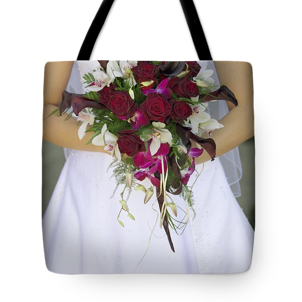 Day Tote Bag featuring the photograph Brides Bouquet And Wedding Dress by Darren Greenwood