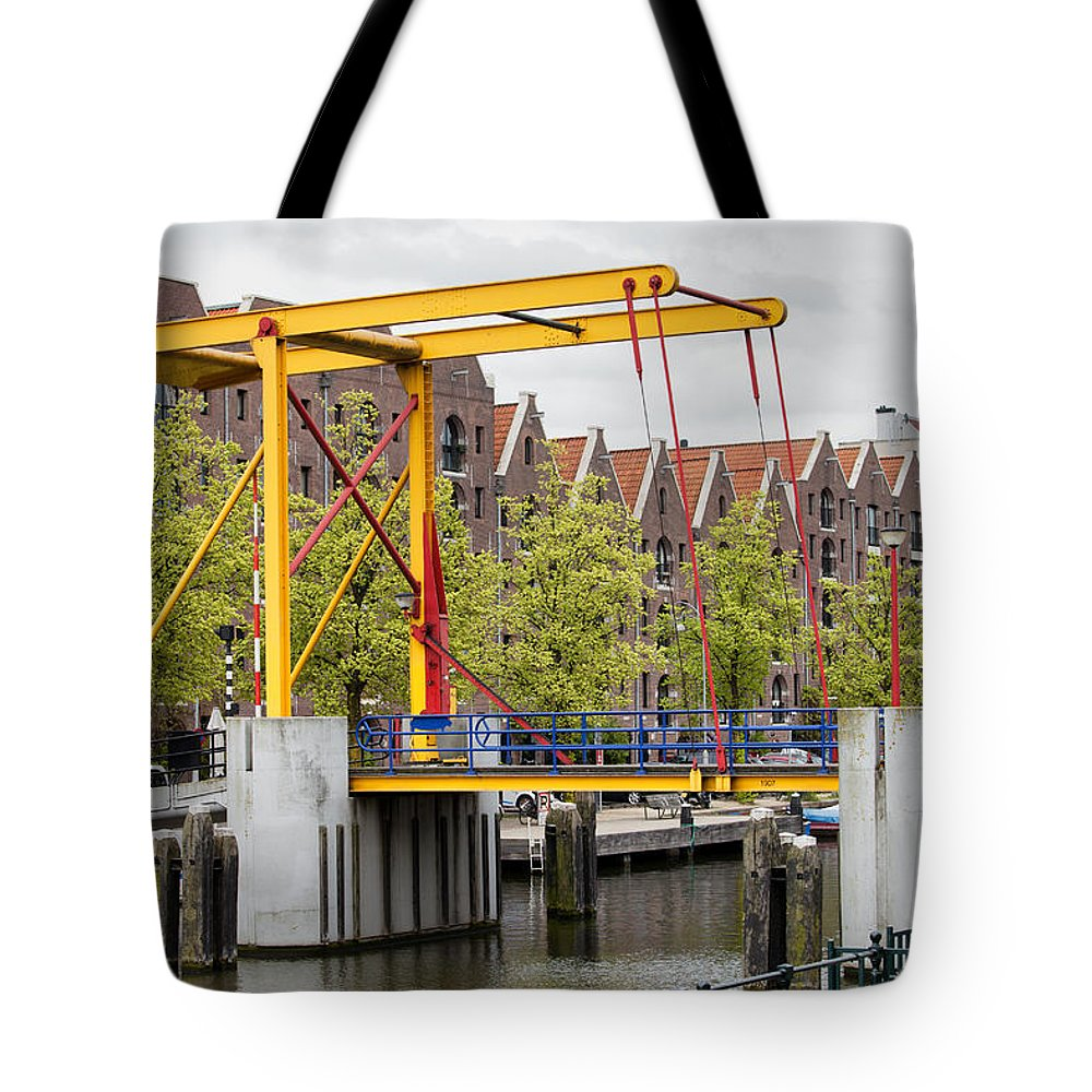 Amsterdam Tote Bag featuring the photograph Bridge And Houses On Entrepotdok In Amsterdam by Artur Bogacki