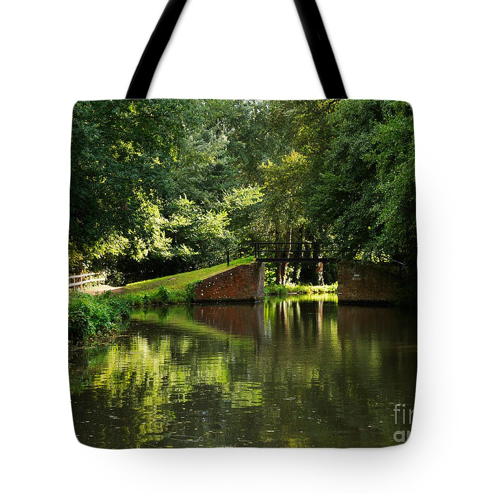 English Canals Tote Bag featuring the photograph Bridge Over The Wey Navigation In Surrey by Louise Heusinkveld