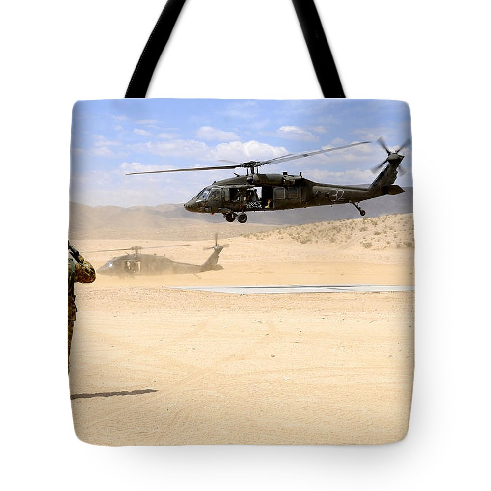 Helicopter Tote Bag featuring the photograph Brigade Aviation Officer Salutes by Stocktrek Images