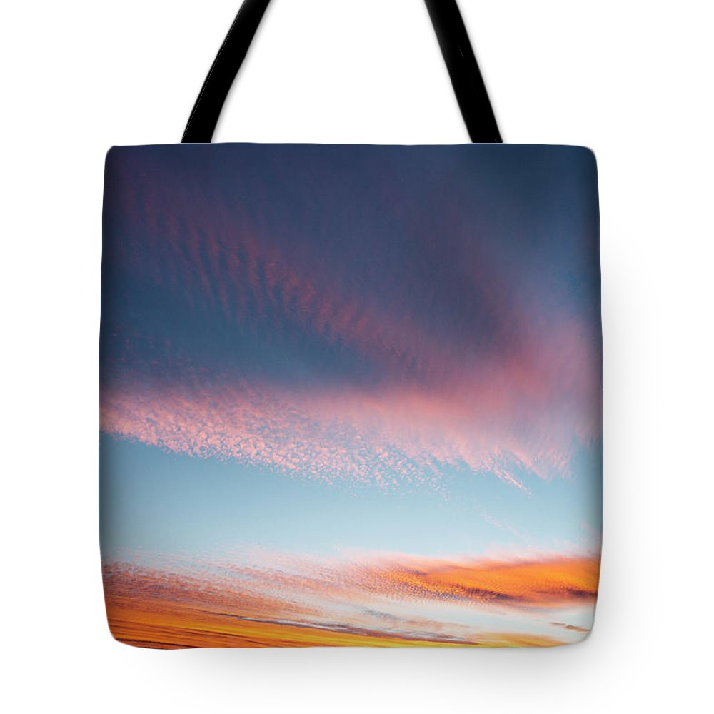 Sunset Tote Bag featuring the photograph Broad Brushstrokes Of Clouds Paint by Robbie George
