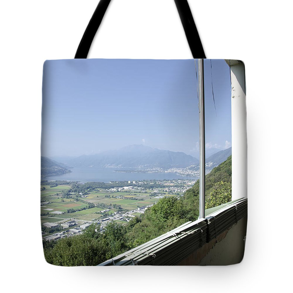 Window Tote Bag featuring the photograph Broken Windows With Panoramic View by Mats Silvan