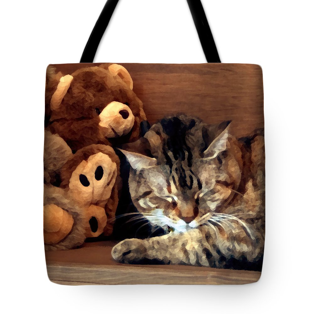 Tabby Tote Bag featuring the photograph Brownie by Jeanne A Martin