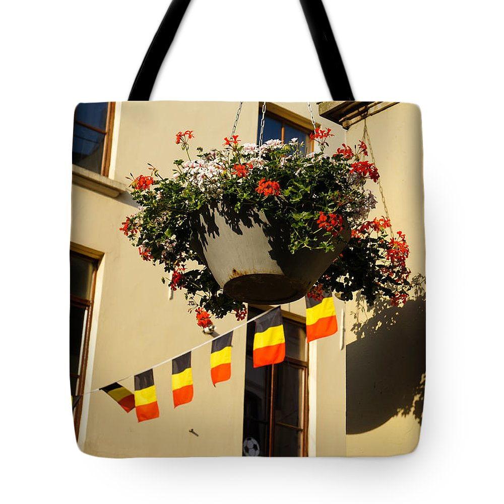 Brussels Tote Bag featuring the photograph Brussels Belgium - Flowers Flags Football by Georgia Mizuleva