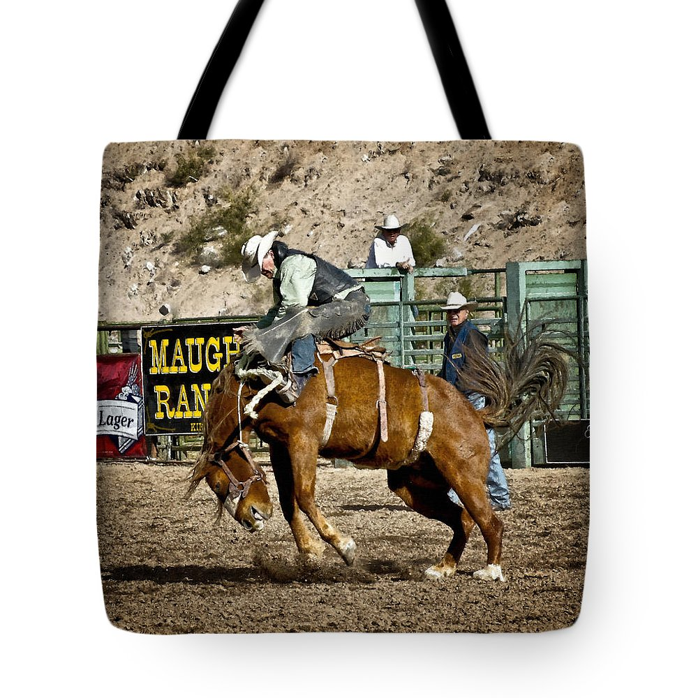 Bucking Bronco Tote Bag featuring the photograph Bucking Bronco At Wickenburg Senior Pro Rodeo by Priscilla Burgers