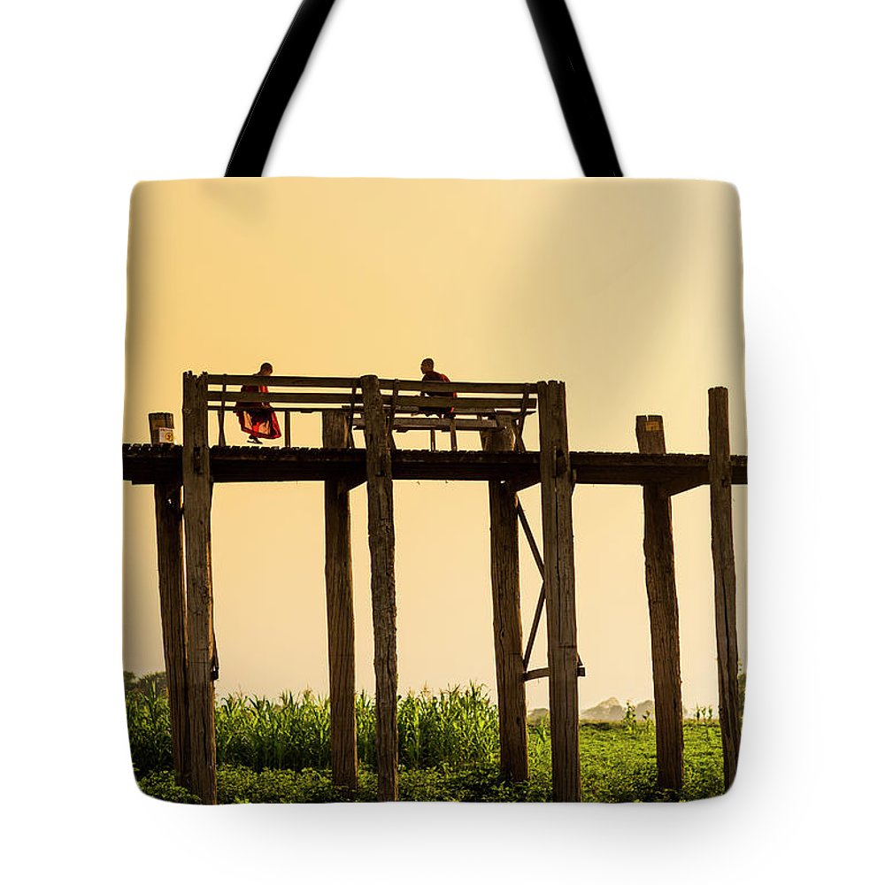 Grass Tote Bag featuring the photograph Buddhist Monks Seated On U Bein Bridge by Merten Snijders