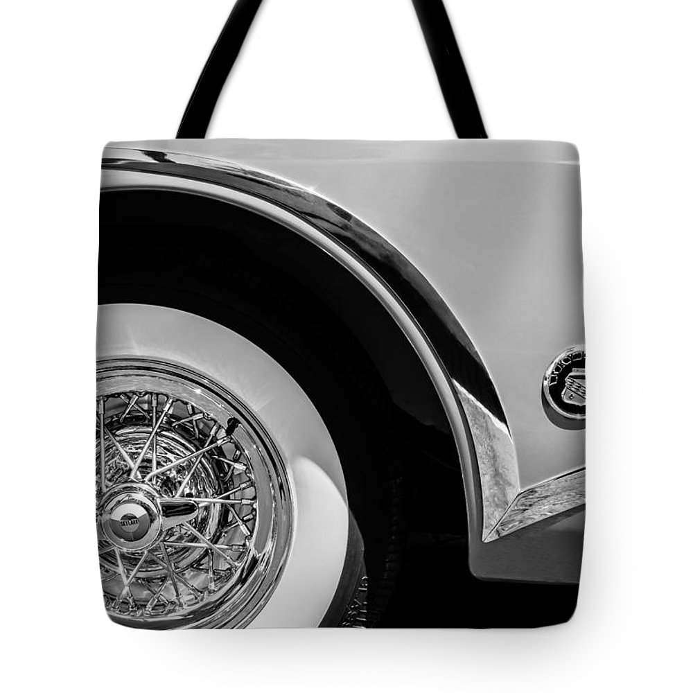 Buick Skylark Wheel Emblem Tote Bag featuring the photograph Buick Skylark Wheel Emblem by Jill Reger