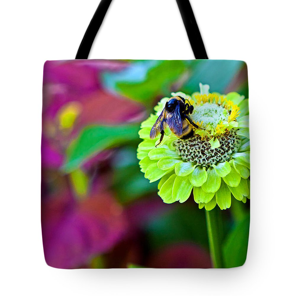 Bumble Bee On A Green Flower Tote Bag featuring the photograph Bumble Bee by Sennie Pierson