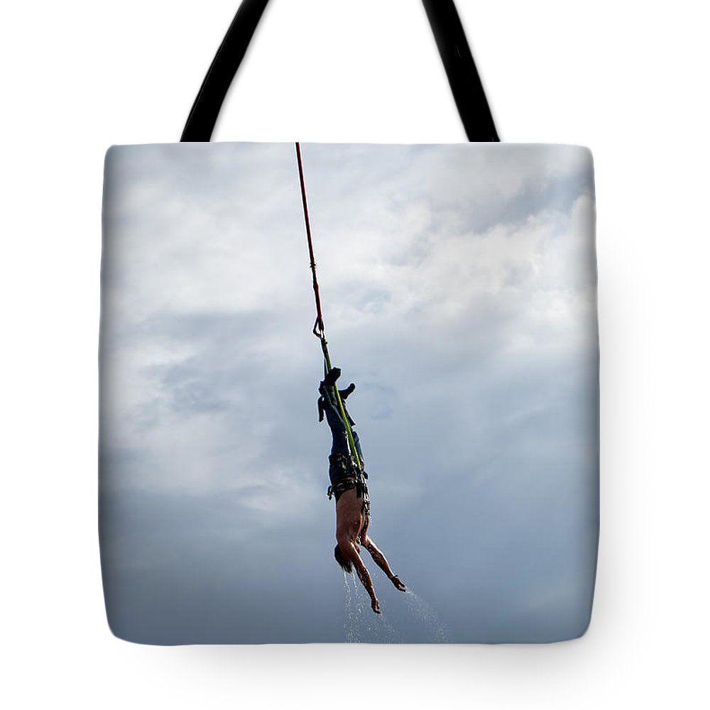 Soked Tote Bag featuring the photograph Bungee Jumper Soaked by Antony McAulay