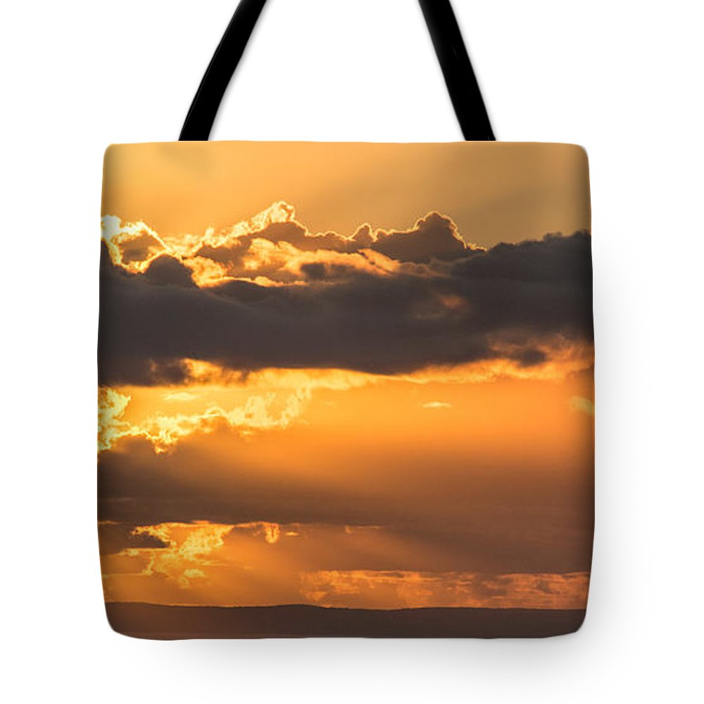 Sunset Tote Bag featuring the photograph The Trumpet Sound by Parker Cunningham