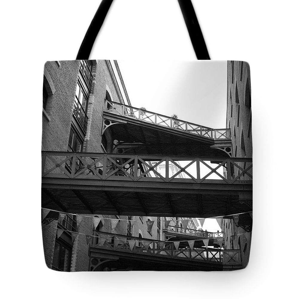 Butlers Warf London Black White Photograph Balcony City Street House Warehouse  Tote Bag featuring the photograph Butlers Warf by Steve K