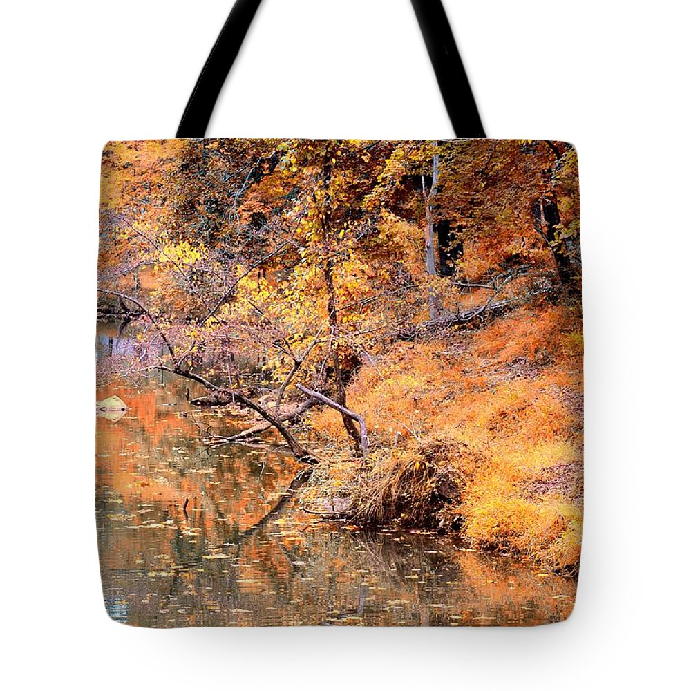 By The Bank Of The Golden Forest Tote Bag featuring the photograph By The Bank Of The Golden Forest by Maria Urso