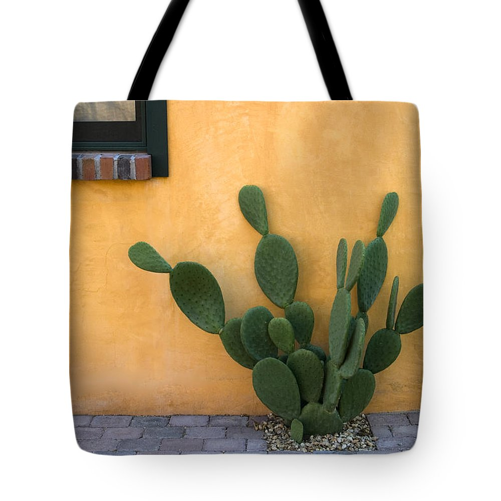 Tucson Tote Bag featuring the photograph Cactus And Yellow Wall by Carol Leigh