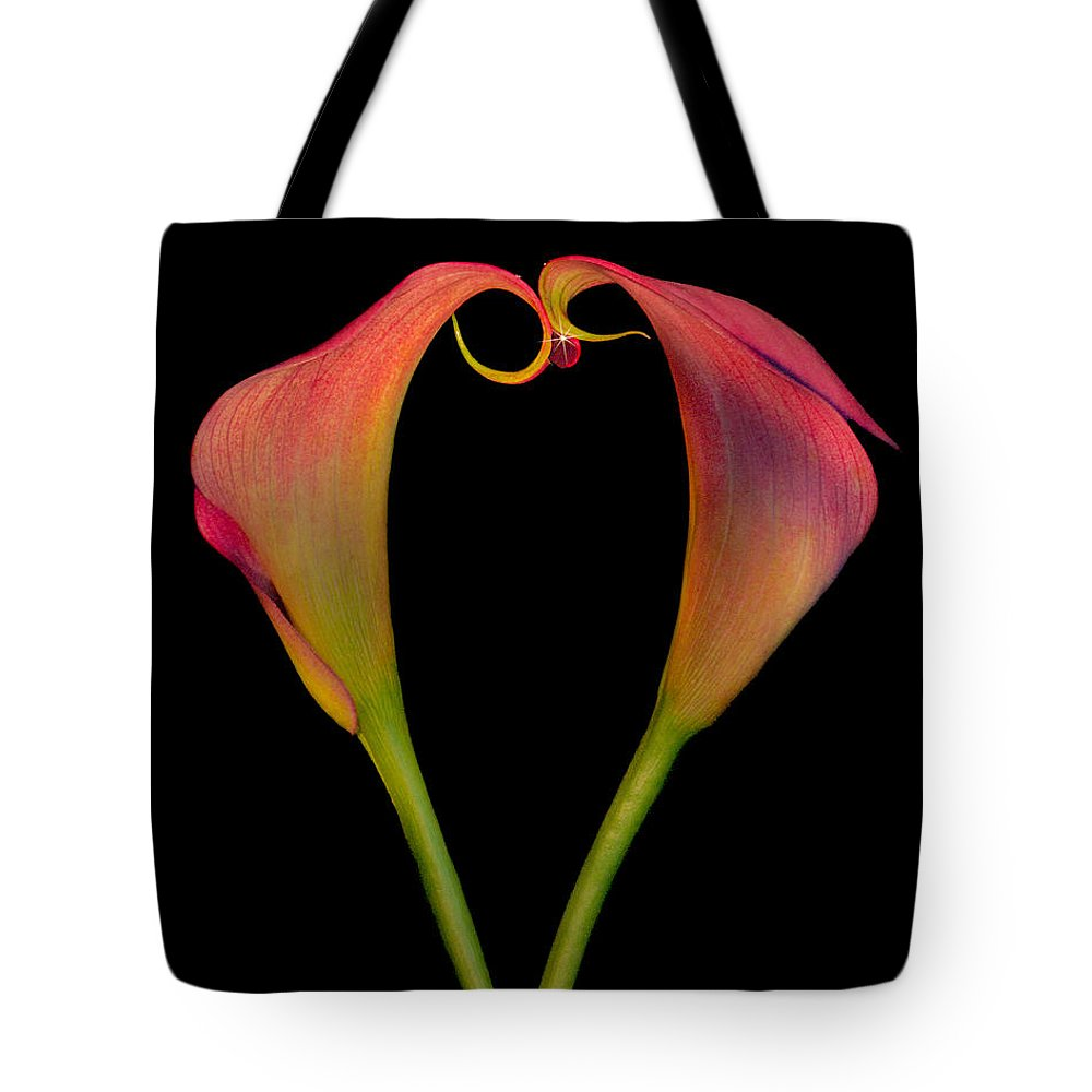 Calla Lilies Tote Bag featuring the photograph Calla Lillies Kissing by Susan Candelario