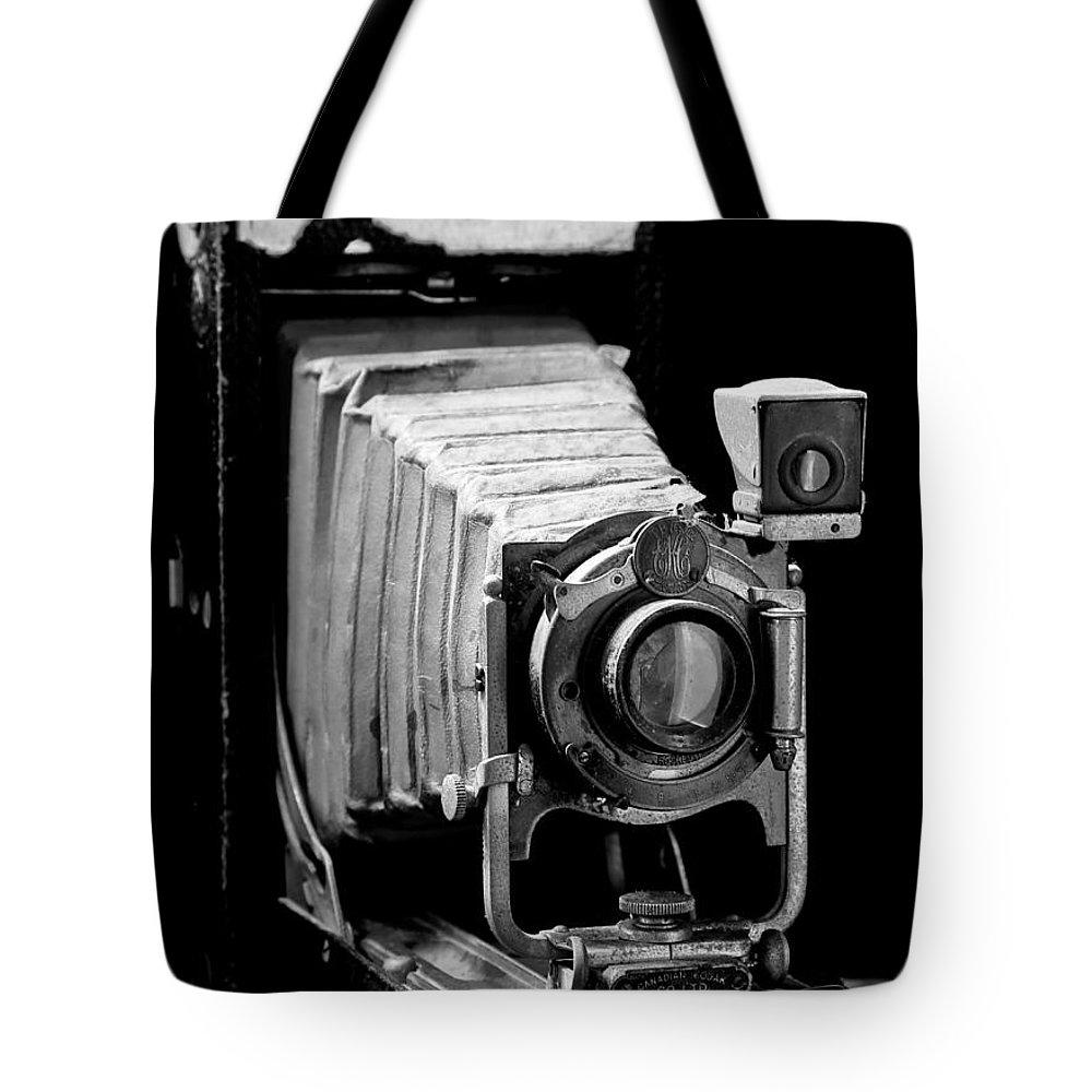 Vintaged Canadian Kodak Camera Tote Bag featuring the photograph Canadian Kodak Black And White Camera by Athena Mckinzie