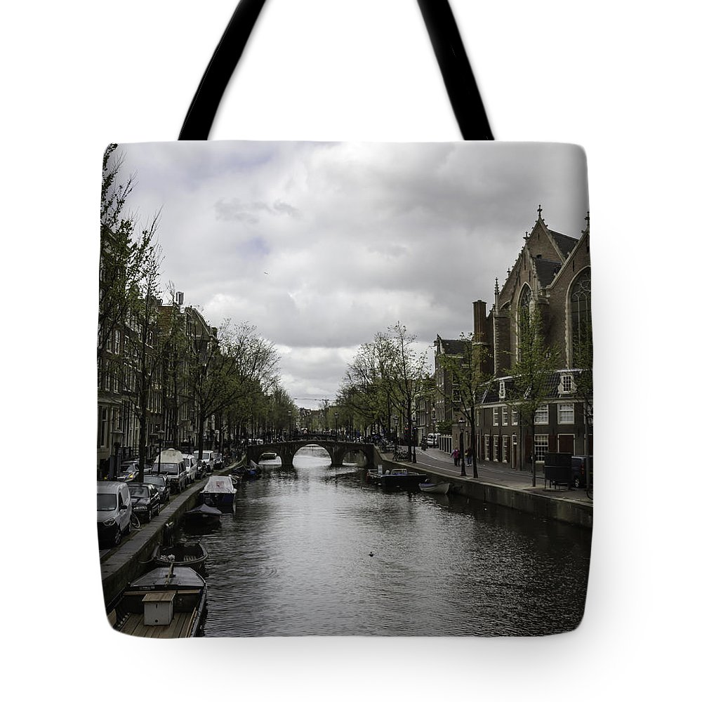 2014 Tote Bag featuring the photograph Canal Behind Oude Kerk In Amsterdam by Teresa Mucha