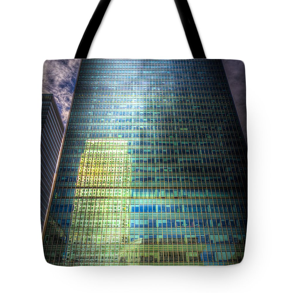 Canary Wharf Tower Tote Bag featuring the photograph Canary Wharf Reflections by David Pyatt