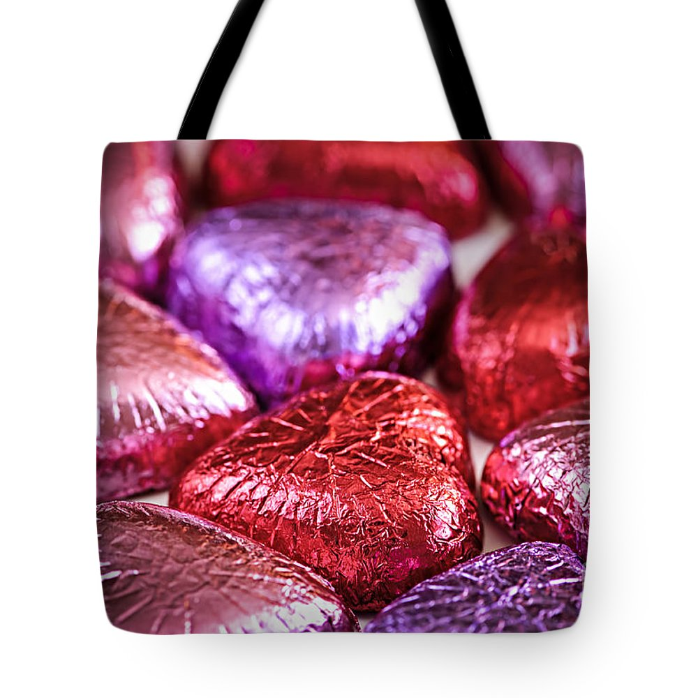 Candy Tote Bag featuring the photograph Candy Hearts by Elena Elisseeva