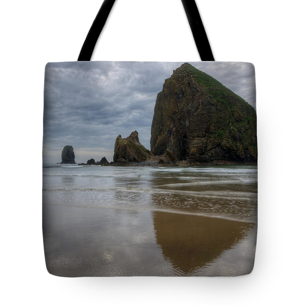 Cannon Beach Tote Bag featuring the photograph Cannon Beach Haystack Reflection by Bob Christopher