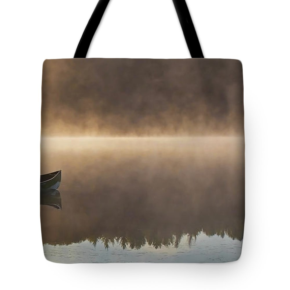 Canoe Tote Bag featuring the photograph Canoeist On A Golden Misty Morning by Barbara McMahon