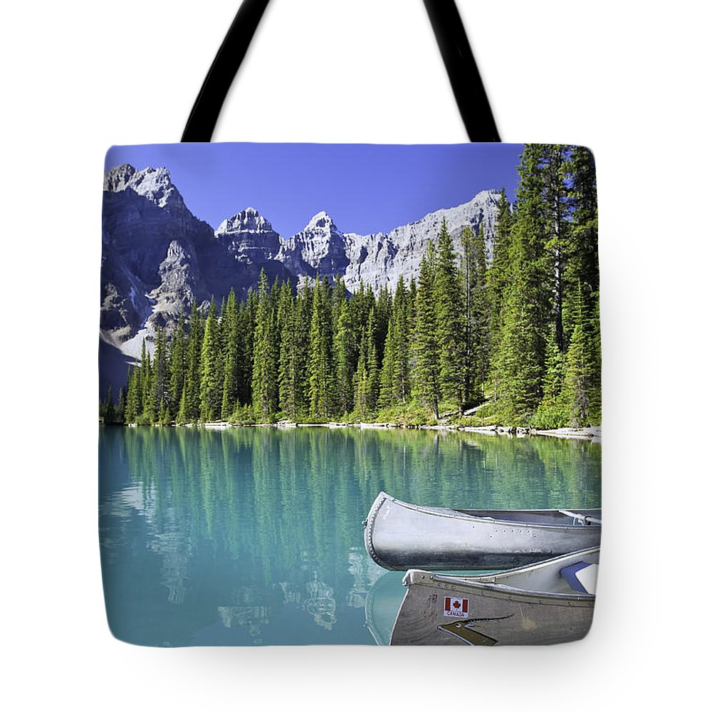 Light Tote Bag featuring the photograph Canoes In Moraine Lake And Valley Of by Ken Gillespie