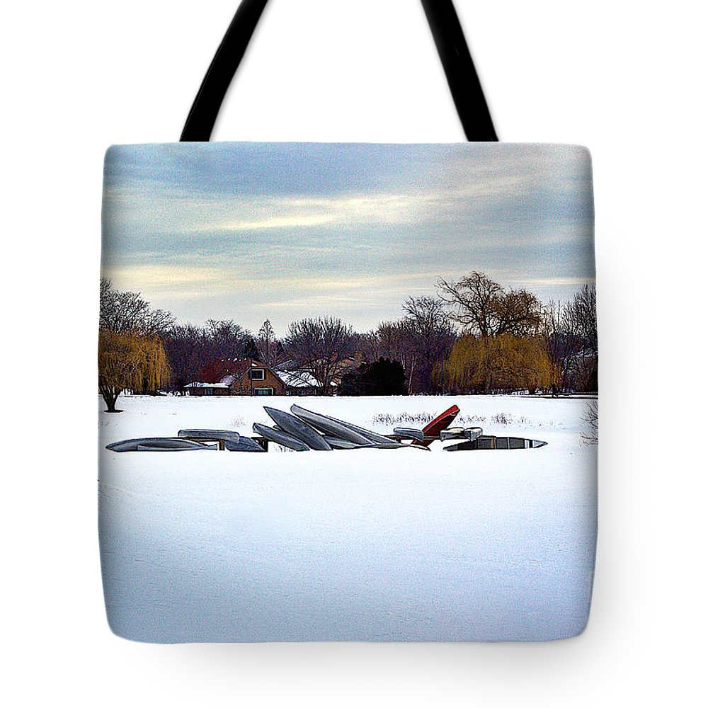 Canoe Tote Bag featuring the photograph Canoes In The Snow by Frank J Casella