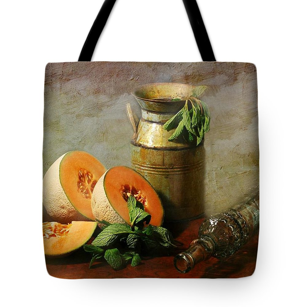 Still Life Tote Bag featuring the photograph Cantaloupe by Diana Angstadt