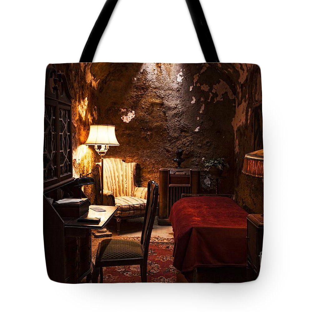 Al Capone Tote Bag featuring the photograph Captive Luxury by Andrew Paranavitana