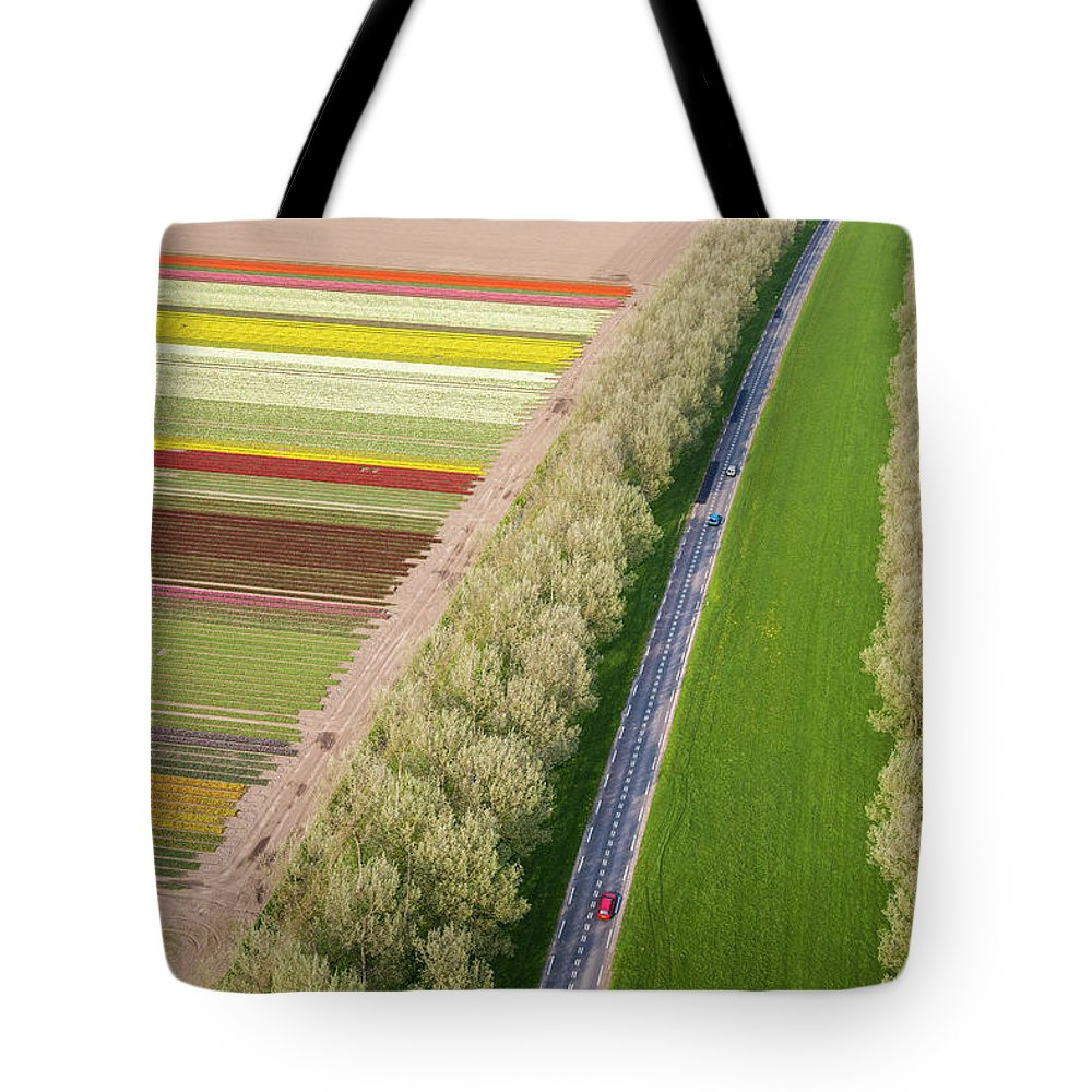 Scenics Tote Bag featuring the photograph Car On Road Near Tulip Fields, Holland by Peter Adams