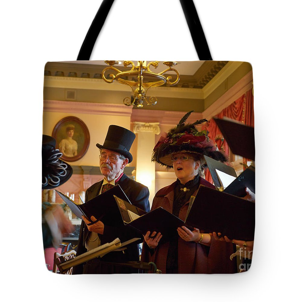 Carol Tote Bag featuring the photograph Carol Singers At Christmas by Louise Heusinkveld