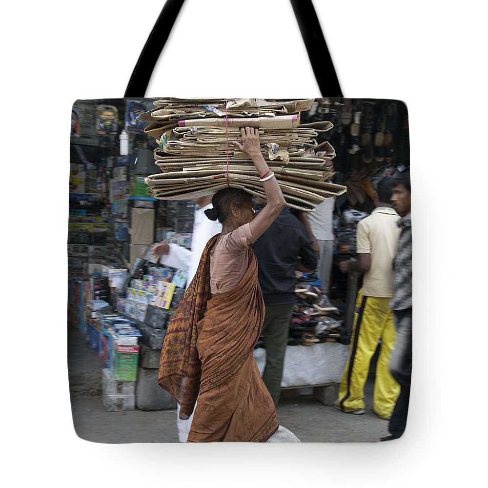 India Tote Bag featuring the photograph Carrying Cardboard by Sonny Marcyan