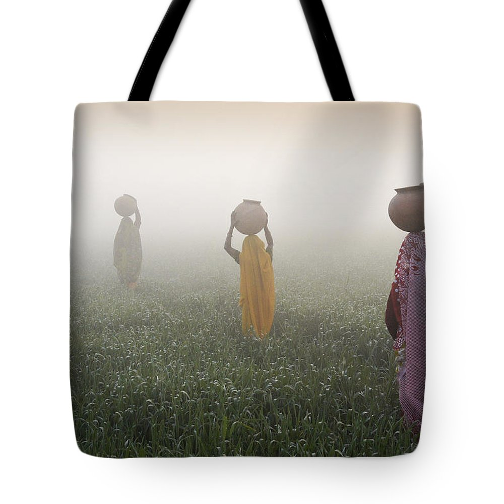 Asia Tote Bag featuring the photograph Carrying Water On A Foggy Morn In India by Michele Burgess