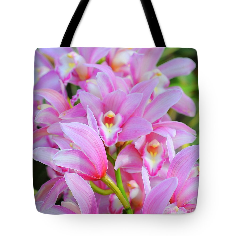 Pink Tote Bag featuring the photograph Cascade Of Pink Orchids by Kathleen Struckle
