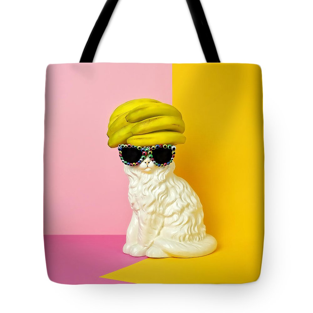 Statue Tote Bag featuring the photograph Cat Wearing Sunglasses And Banana Wighat by Juj Winn