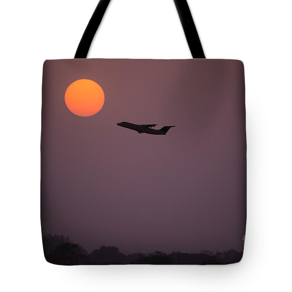 Fly Aeroplane Airplane Travel Sun Sunset Sunrise Fly Sunshine Dawn Dusk Twilight Dramatic Beautiful Flying Air Tourism Sea Shine Shining Vacation Holiday Concept Idea Nobody Summer Horizon Plane Pink Tower Tote Bag featuring the photograph Catch The Sun by Image World