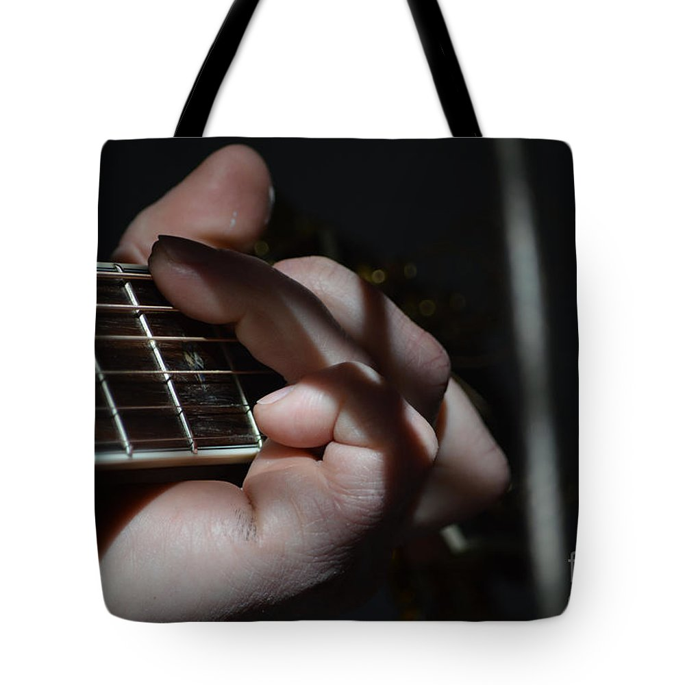 Musician Tote Bag featuring the photograph Catching The Light by Alys Caviness-Gober